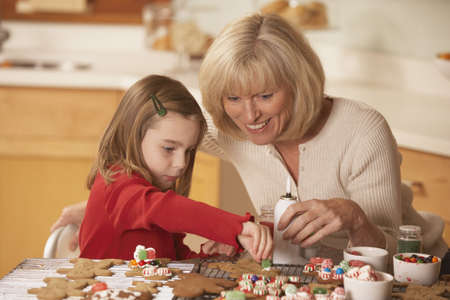 Mother and daughter decorating homemade gingerbread cookies, Richmond, Virginia, United States Stock Photo - 16090287