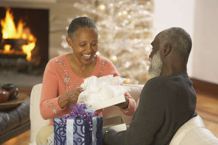 Senior African couple opening presents, Richmond, Virginia, United States Stock Photo - 16090288