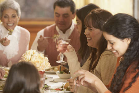 eating area: Hispanic family eating at the dinner table, Richmond, Virginia, United States LANG_EVOIMAGES