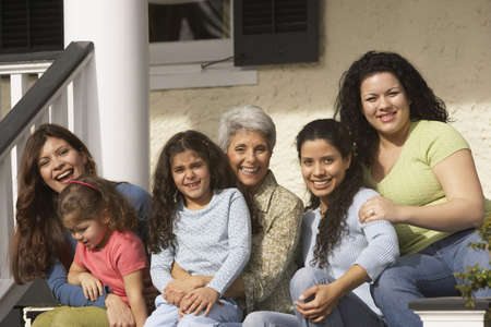 gramma: Female Hispanic family members sitting on the porch smiling, Richmond, Virginia, United States