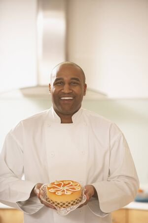African male pastry chef holding a cake, Richmond, Virginia, United States Stock Photo - 16090317