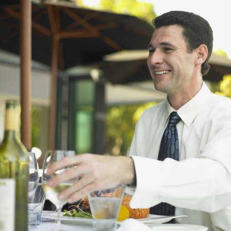 Man sitting at restaurant table, Perth, Australia Stock Photo - 16090320