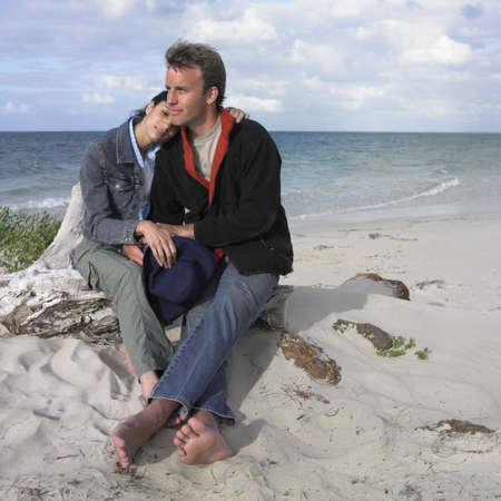 busselton: Couple sitting on the beach, Busselton, Australia