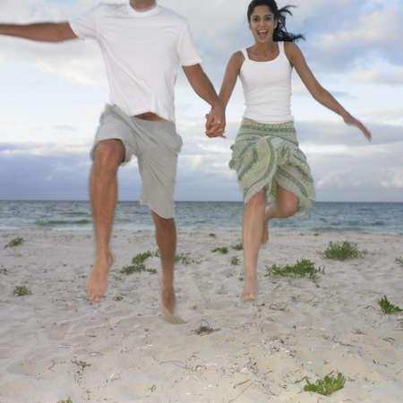 busselton: Couple jumping on the beach, Busselton, Australia LANG_EVOIMAGES