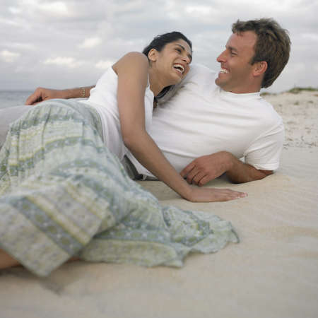 busselton: Couple lying on the beach, Busselton, Australia