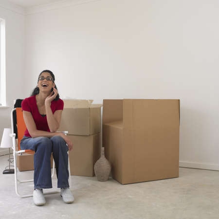 busselton: Woman sitting next to boxes in new house
