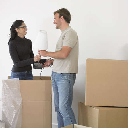 busselton: Couple unpacking boxes in new house LANG_EVOIMAGES