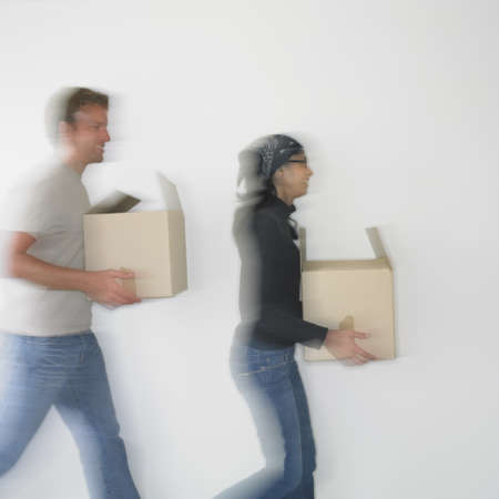 busselton: Couple with boxes in new house