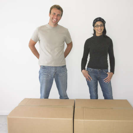 Couple with boxes in new house Stock Photo - 16090365