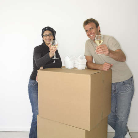 Couple eating take out on boxes in new house Stock Photo - 16090367