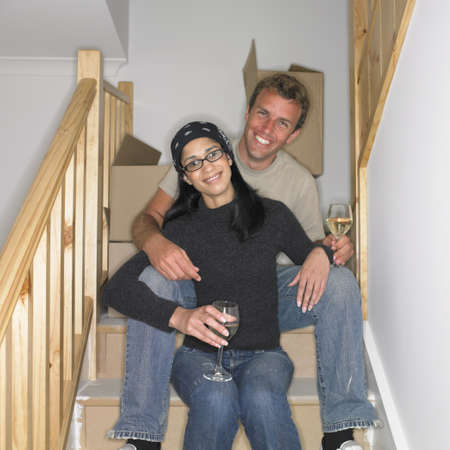 busselton: Couple having a drink on stairs in new house