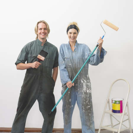 Couple getting ready to paint a wall Stock Photo - 16090370