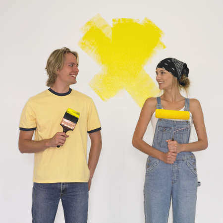 Couple painting a wall Stock Photo - 16090375