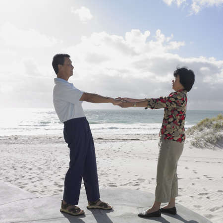 australian ethnicity: Asian holding hands on the beach, Perth, Australia
