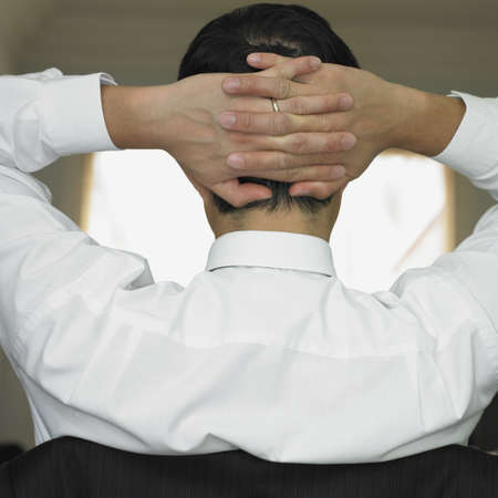 Rear view of man's hand clasped behind his head Stock Photo - 16090386