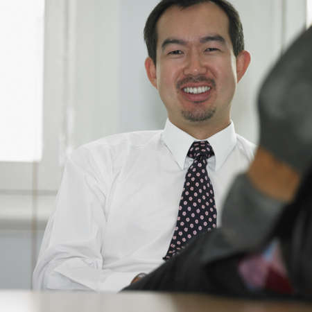 Asian businessman smiling Stock Photo - 16090387
