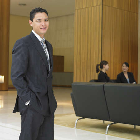 Businessman standing in lobby Stock Photo - 16090391