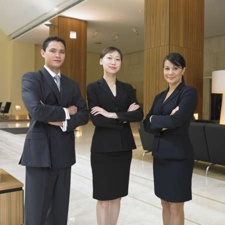 western attire: Businesspeople standing in lobby LANG_EVOIMAGES
