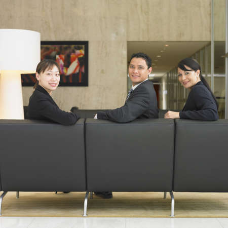 Businesspeople sitting in lobby Stock Photo - 16090394