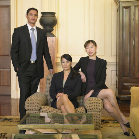 Businesspeople sitting in lobby Stock Photo - 16090395