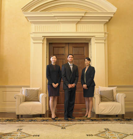 Businesspeople standing in waiting area Stock Photo - 16090397