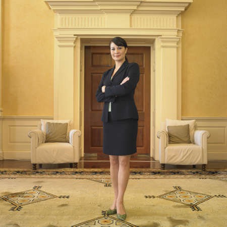 Businesswoman standing in waiting area Stock Photo - 16090399