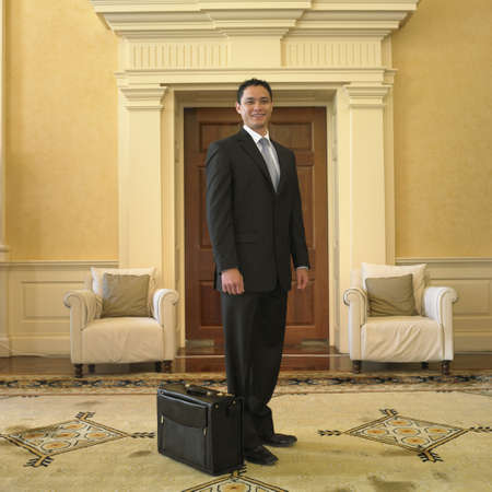 Businessman with briefcase in waiting area Stock Photo - 16090400