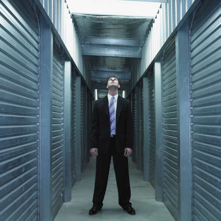 Businessman standing in storage unit hallway Stock Photo - 16090410
