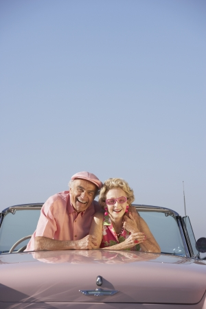Senior couple in a pink convertible Stock Photo - 16090420