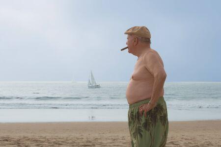 Senior man smoking a cigar on the beach, Las Vegas, Nevada, United States