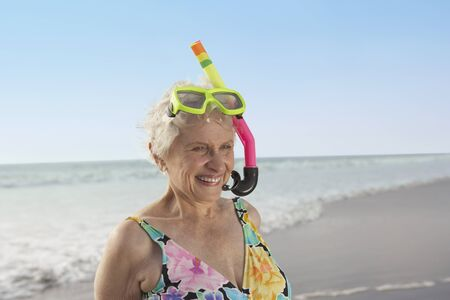 Senior woman wearing snorkeling gear on the beach, Las Vegas, Nevada, United States