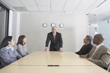Senior businessman presiding over meeting Stock Photo - 16090436