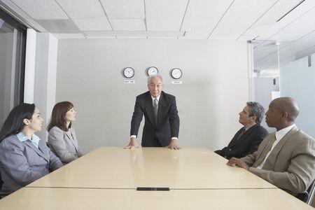 north western european descent: Senior businessman presiding over meeting LANG_EVOIMAGES