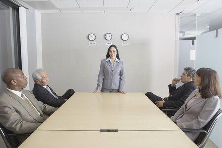 Asian businesswoman presiding over meeting