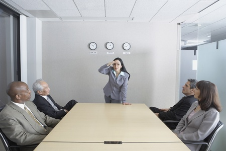 Hispanic woman presiding over meeting