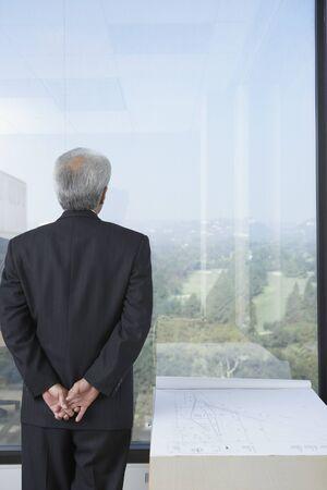 Senior businessman with at blueprints, Los Angeles, California, United States Stock Photo