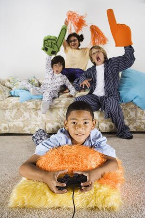 north western european descent: Group of children playing video games