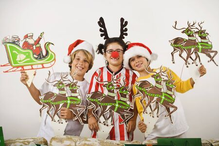 decoration: Group of children with christmas decorations LANG_EVOIMAGES
