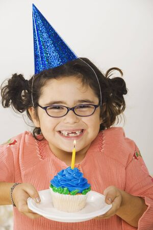 Young girl with birthday cupcake Stock Photo - 16090477