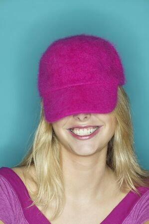 gaithersburg: Close up of girl smiling with hat covering her eyes