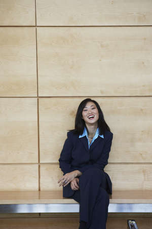 Asian businesswoman sitting on bench indoors Stock Photo - 16090490