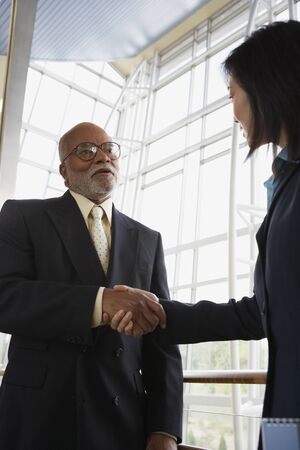 Two businesspeople shaking hands, North Bethesda, Maryland, United States Stock Photo - 16090481