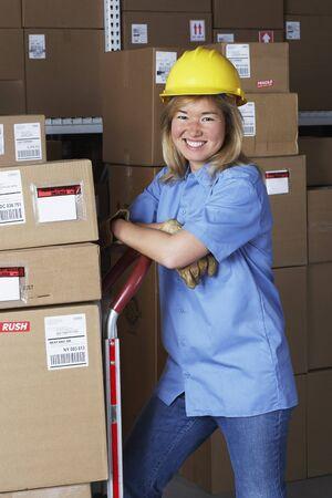gaithersburg: Female warehouse worker with hard hat