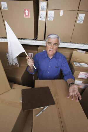 gaithersburg: Businessman in warehouse waving white flag