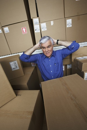 storing: Frustrated businessman in warehouse