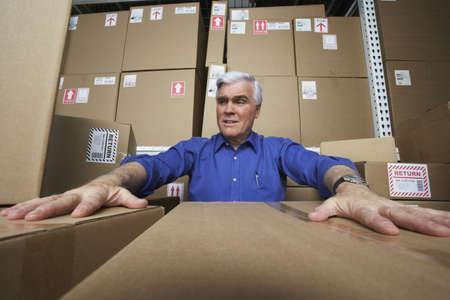 gaithersburg: Frustrated businessman in warehouse