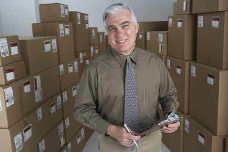 gaithersburg: Businessman in warehouse with clipboard