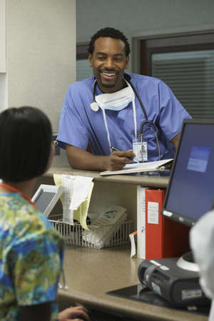 African male surgeon talking to nurse, Bethesda, Maryland, United States Stock Photo - 16090523