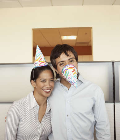 Co-workers joking around at office party Stock Photo - 16090551