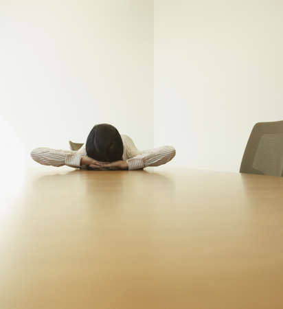 casualness: Businesswoman lying on conference table